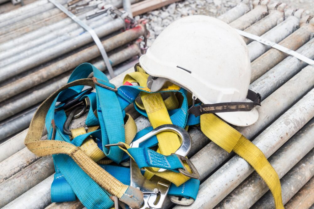 Safety helmet and safety harness at a construction site